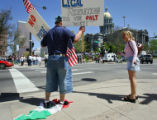 Israel Becerra (cq, left), 25, of Denver stands on a Mexican flag while making his feelings known...