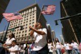 (CENTER) Waving United States of America flags Oscar Carreon (CQ), 28, of Thorton was among the...
