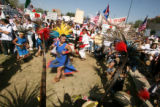 (CENTER) A Aztec dancer with Grupo Tlaloc, performs a ceremonial dance at Viking Park before the...