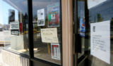 Signs informing customers that businesses were closed where common in some neighborhoods, like...