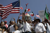 "Rally goers cheer during a "" We are America /Somos America"", a national day of action ..."