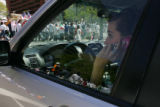 Brett Duncan, cq, Denver, talks to her mother while waiting more than 40 minutes at a blocked...
