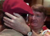 (DENVER, Colo., March 21, 2005) T.J. McGinty, Assistant Scout Master, adjusted all the berets of...