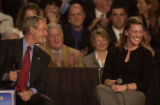 (DENVER, Colo.,  March 21, 2005) President George W. Bush (cq left) talks with Joleen Mossoni...
