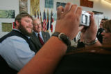 (from left) Brian Strain (cq) has his photograph taken with Democratic National Committee Chairman...