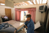 MJM047 Kathryn McCracken (cq) examines the bedroom in her damaged home in Holly, Colo. Thursday...
