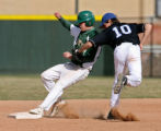 Machebeuf player Dugan Taylor is tagged out at second by Denver Christian shortstop G.J. Henry on...