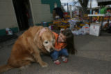 DLM1337  Megan Frausto, 4, visits with Summer, a resident dog at the Colorado Humane Society,...
