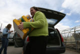 DLM1550  Lauren Hayutin, 26, unloads cases of dog food from her car in Englewood, Colo. Tuesday,...