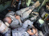 04/05/2005 Iraq-PVT Elam Lewis, 21, left, and SSG Justin Vasquez, 26, rest in the back of a...