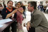John Youngquist (cq) (r), principal of Smedley Elementary School in Northwest Denver, listens to...