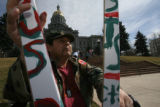 454 year-old James Narvaiz from Thornton gathers in front of the State Capitol in downtown Denver,...