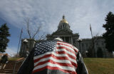 Ron Hall (cq), age 65 walks up the steps of the State Capitol in downtown Denver, as discussions...