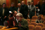 MJM350 Alan Gilbert is huried to finish his remarks as others wait to speak at a hearing in the...