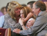 Jamie Kois, middle, sister of Jennifer Nicole Kois, 19, of Brighton  who was killed March 22, 2007...