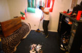 (COMMERCE CITY, CO. APRIL 6, 2005) Luis Hernandez (CQ. Luis Hernandez), 14, clean his bedroom...