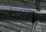 John Wood, cq, of Fox Sports Rocky Mountain, installs a robotic camera in the snow Thursday Mar....