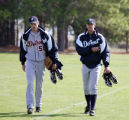 Detroit Tigers pitchers Andrew Miller, left, and Kyle Sleeth, right, walk off the practice field...