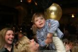 Cristina Wood, (cq), left, watches as her mother Linda Sollars, (cq), holds up her grandson Ethan...