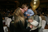 Cristina Wood, (cq), left, kisses her son Ethan Wood, 2, held by her mother Linda Sollars, (cq),...