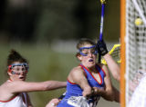 Cherry Creek's Perrie White, right, makes good on a shot on goal being defended by Kent Denver's...