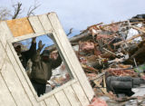 Salvador Orta (cq), left, and Mario Sanchez (cq), right, clear debris in Holly, Colo., Friday,...