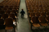 Henry Carson, 2, runs up the aisle in the auditorium of Brown International Elementary School...