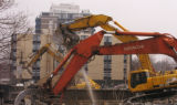 (DENVER Colo., March 23, 2005)  Heavy machinery works on bringing down the old Mercy Hospital at...