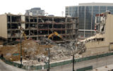 (DENVER Colo., March 23, 2005)  Heavy machinery works on bringing down the old LoDo Post Office...
