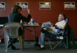 Rep. Tom Tancredo works on a statement at his headquarters with his senior advisor Bay Buchanan,...