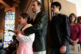 L-R, Joseph Sekrieh holds his duaghter Yara, 9 with his son Fouad, 15 behind him  during the...