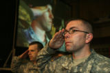 Colorado Army National Guard, SFC David Demoss (right) and MSA Jast Jevald salute the flag of the...