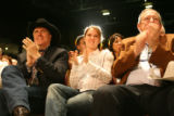 "Bill Ritter (far left) and his daughter (center) watch the peformance as ""Operation Blizzard..."