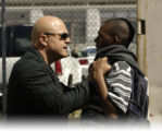 THE SHIELD: Det. Vic Mackey (Michael Chiklis, L) confronts a suspected criminal on THE SHIELD...
