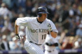 BG0392 Rockies outfielder Brad Hawpe blasts a two-run RBI single in the first inning of the...
