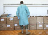Specialist Ben Miller, (cq), a medical lab technician oversees loading pints of blood in boxes for...