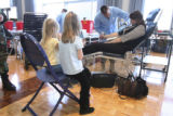 Jill Lucas, (cq), mom, donating blood is assisted by SSG. Joel Brayman, (cq), a blood technician,...