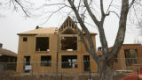 A crew of Costello Construction, is putting up this new duplex in the 600 block of Ogden St.,...