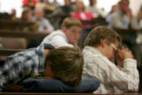 Seventh grader, from Everitt Middle School, Kollin Olsen, places his head on his folded sweatshirt...