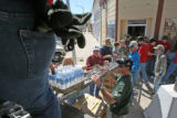 Members of the Church of Jesus Christ unload water, food, clothing and toiletries off Main Street...