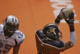 Colorado Crush wide receiver Damian Harrell, right,  pulls down a touchdown pass in the second...