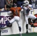 Colorado Crush defensive back Rashad Floyd, left, pulls the face mask of Nashville wide receiver...
