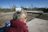 89 year-old Louise Neill (cq) sits in what used to be the front porch of her home on Highland St....
