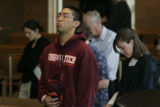 Kyle Hudencial, (cq) 20 and a sophomore exhales during a prayer service at the St. John Francis...