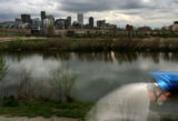 MJM035 A bicyclist is a near blur as he rides through Confluence Park in Denver Monday, April 16,...