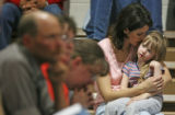 April 2, 2007. Michelle Weimer (cq) and her 4 year-old daughter Rose Lynn Weimer (cq) join in a...
