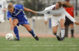 Aurora, Colo., photo taken May 25, 2004- Broomfield's Emily VanAbel (left #14) tries to hold off...