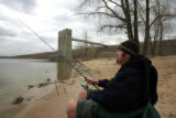 Jeffrey Maltzahn (cq), of Denver, enjoys an afternoon fishing at Cherry Creek Reservoir, April 16,...