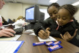 DLM0173  Tia Finlayson, 21, helps her daughter Tabreya Wofford, 3, pass the time by drawing...