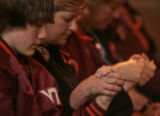 Brock Jaeger (CQ), left, holds the hand of his aunt Sandy Jaeger (Cq)  as the two joined Virginia...